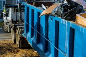 By hiring a junk removal company